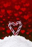 Christmas background with snow and hearts Royalty Free Stock Image