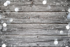 Christmas background with snow and lights on wood Royalty Free Stock Photos