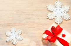 Christmas background. Snowflake and gift. Stock Image