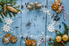 Christmas background with snowflake, gingerbread, candy cane, hearts and fir tree decoration. Royalty Free Stock Images