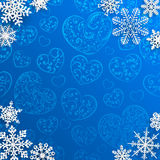 Christmas background with snowflakes on background of hearts Royalty Free Stock Photo