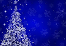 Christmas background with snowflakes. In blue colored scenery Royalty Free Stock Images