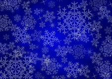 Christmas background with snowflakes. In blue colored scenery Stock Images