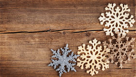 Christmas background. Snowflakes border on grunge wooden board. Stock Photo