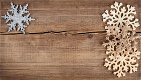 Christmas background. Snowflakes border on grunge wooden board. Stock Images