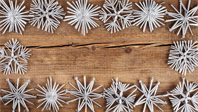 Christmas background. Snowflakes border on grunge wooden board. Royalty Free Stock Image