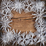 Christmas background. Snowflakes border on grunge wooden board Royalty Free Stock Photos