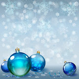 Christmas background with snowflakes and Christmas balls. Christmas background with snowflakes, several Christmas balls and serpentines Stock Photo