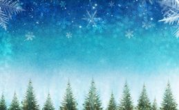 Conceptual christmas winter scene with decorative pine trees against star sky. royalty free stock photos