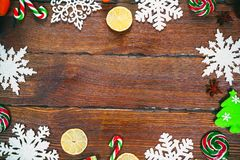 Christmas background with snowflakes, cones, candy, dried oranges and lemons, ornaments, decorations Stock Images