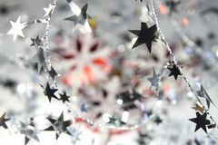 Christmas background of snowflakes and shiny stars Royalty Free Stock Photography