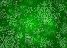Christmas background with snowflakes. In green colored scenery Royalty Free Stock Photos