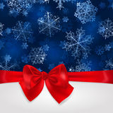 Christmas background with snowflakes and red bow Stock Photos