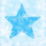 Christmas background with snowflakes and the shape of a star. Blue Christmas background with snowflakes and the shape of a star Royalty Free Stock Image