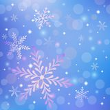 Christmas background with snowflakes and shiny light effects. Christmas cute blue background with snowflakes and shining stars Vector Illustration