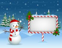 Christmas background with Snowman and blank sign Stock Photo