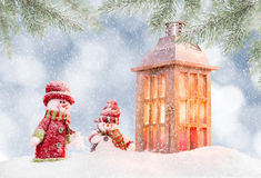 Christmas background with snowman. And falling snow Stock Photos