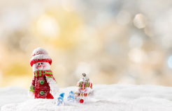 Christmas background with snowman. And falling snow Royalty Free Stock Image