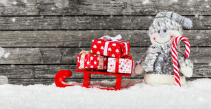 Christmas background with snowman and gifts Royalty Free Stock Photos