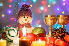 Christmas background with a snowman, glasses and lights royalty free stock photos