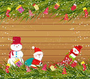 Christmas background with snowman and santa claus on wood. Background christmas and happy new year Royalty Free Stock Photo