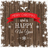 Christmas background with snowy border and wooden texture Royalty Free Stock Image