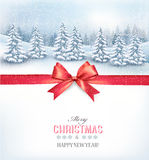 Christmas background with a snowy landscape and a red bow. Stock Photography