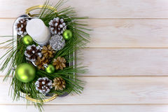 Christmas background with snowy pinecone decorated centerpiece Stock Photography