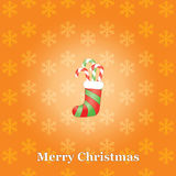Christmas background with sock and candies Stock Images