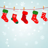 Christmas background with socks hanging on a rope. Christmas background with snowflakes and socks hanging on a rope Royalty Free Stock Photos