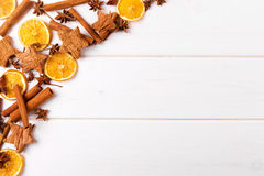 Christmas background with spices on white wooden table Royalty Free Stock Photo