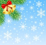 Christmas background with the sprigs of fir-tree and campanellis Royalty Free Stock Image