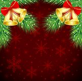 Christmas background with the sprigs of fir-tree and campanellis Royalty Free Stock Images