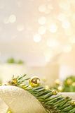 Christmas background with spruce and beads. Christmas seasonal background with spruce and golden beads Stock Photo
