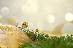 Christmas background with spruce and beads. Christmas seasonal background with spruce and golden beads Royalty Free Stock Image