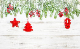 Christmas background. Spruce tree branches with red decoration Stock Photography