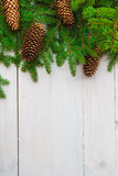 Christmas background spruce twigs cones white wooden Royalty Free Stock Image