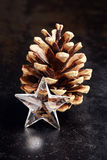 Christmas background with a star and pine cone Stock Photos