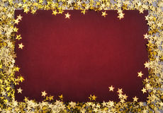 Christmas background with star-shaped confetties Stock Images
