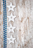 Christmas background with star shapes and chaplet Stock Photography