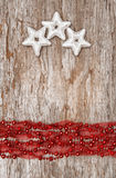 Christmas background with star shapes and chaplet Royalty Free Stock Image