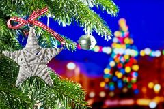 Christmas Background with Christmas Star. On the Tree Stock Photography