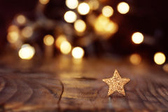 Christmas background with stars and bokeh Stock Photos