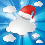 Christmas background with sun rays, clouds and Red Sant Stock Image