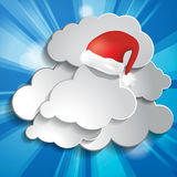 Christmas background with sun rays, clouds and Red Sant Royalty Free Stock Photos