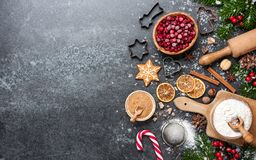 Christmas background. Table for holiday baking cookies with ingredients. Copy space royalty free stock photo