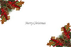 Christmas background tag pine cones red berries and boarded by festive garland Royalty Free Stock Photography