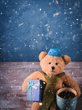 Christmas background with a teddy bear Stock Images