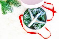 Christmas background on the theme of travel. The plane symbolizes the gift of the journey. Selective focus. Holiday stock photo