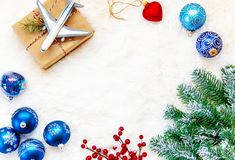 Christmas background on the theme of travel. The plane symbolizes the gift of the journey. Selective focus. Holiday royalty free stock images